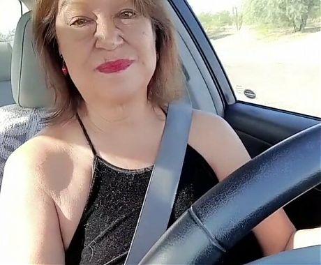 Mature woman not wearing panties pissing in parking lot