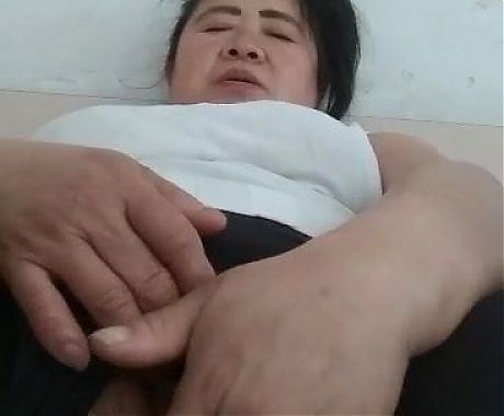 Asian granny masturbating